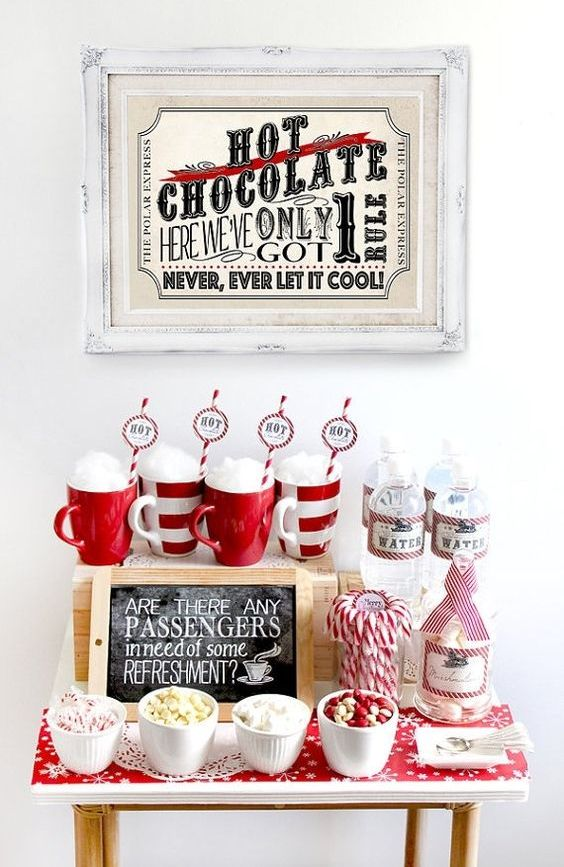 a gorgeous festive hot chocolate station with sweets done in traditional red and white