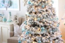 09 a gorgeous flocked coastal Christmas tree with blue and pearly ornaments plus lights and star fish