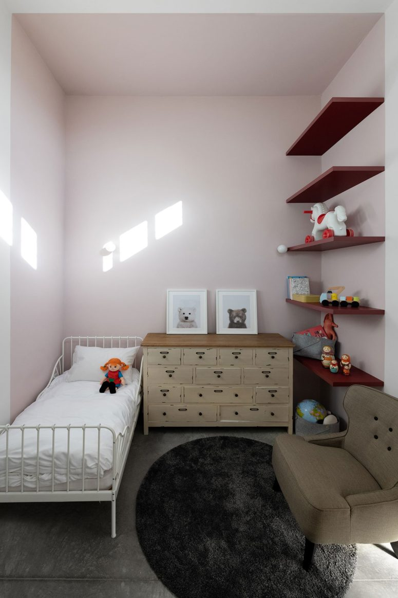 The kid's room is done with light pink, neutrals and open shelving