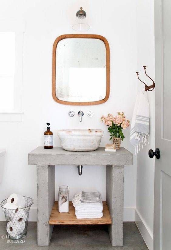 a concrete vanity is a cool and unexpected idea for a modern bathroom, it's a simple way to refresh it