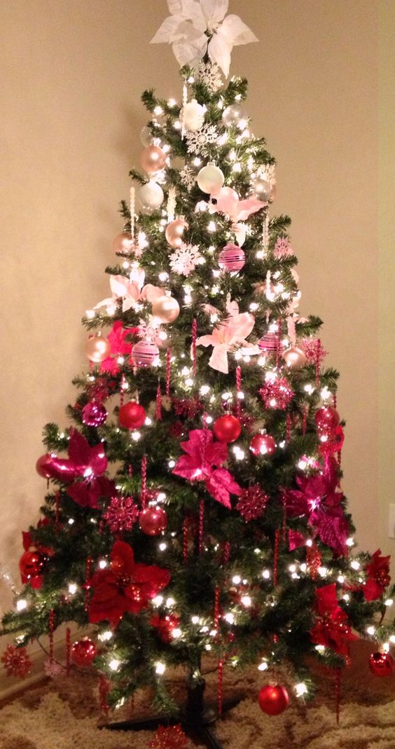 a fun and bold Christmas tree with ornments from pearl and silver to pink, hot pink and red plus lights and icicles