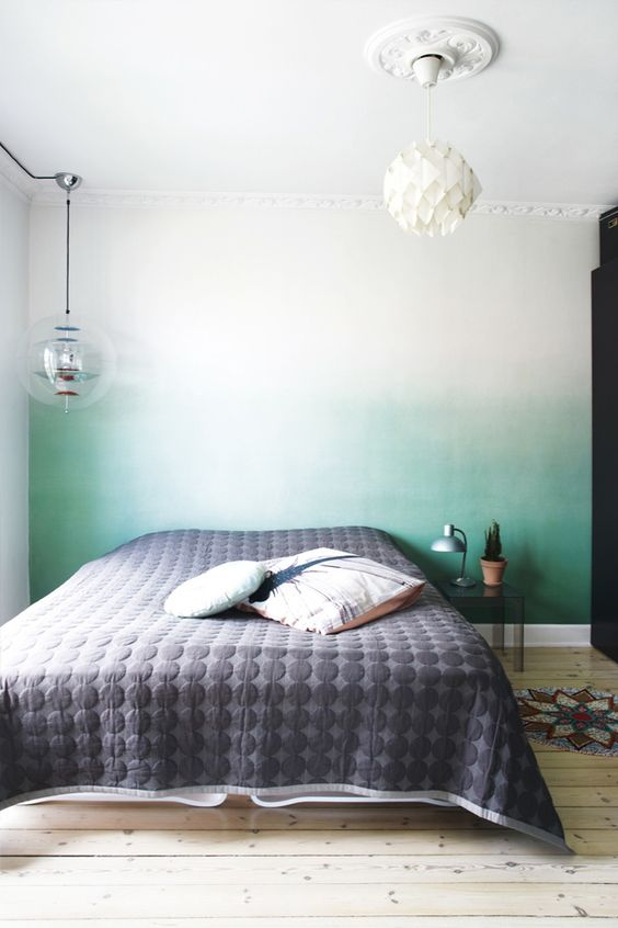 an ombre green statement wall behind the headboard is a peaceful yet catchy touch of color to the bedroom
