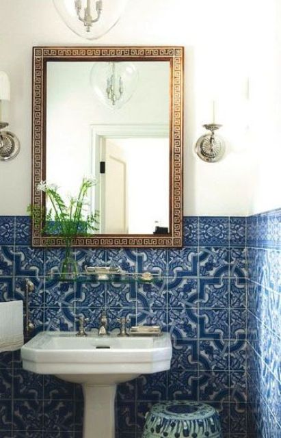 blue mosaic tiles in the bathroom and an ornate mirror frame are amazing for a Mediterranean bathroom