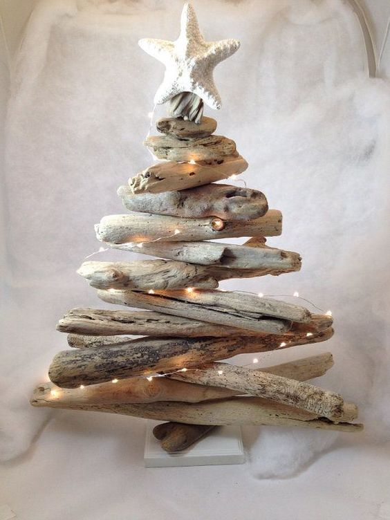 make a driftwood Christmas tree with lights and a star fish topper to decorate a mantel or a shelf