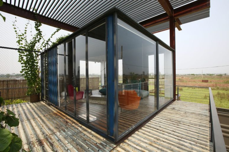 The roof also contains a bedroom, which is fully glazed to catch the views