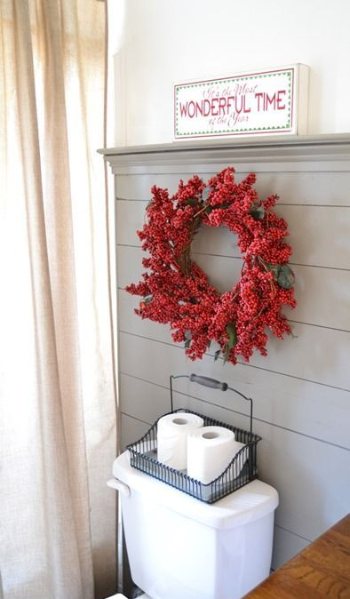 a fake berry wreath is a cute and nice idea, which can be used even in a bathroom to bring festive spirit in