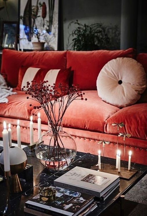 a bold coral velvet sofa will become a centerpiece of your living room thanks to its color and texture
