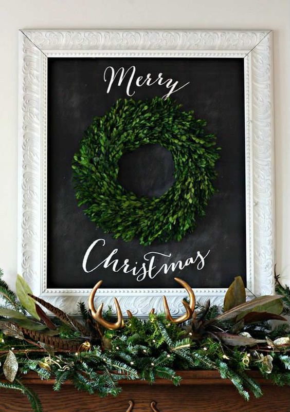 a boxwood Christmas wreath and a lush evergreen garland with lights, foliage, feathers and fake antlers