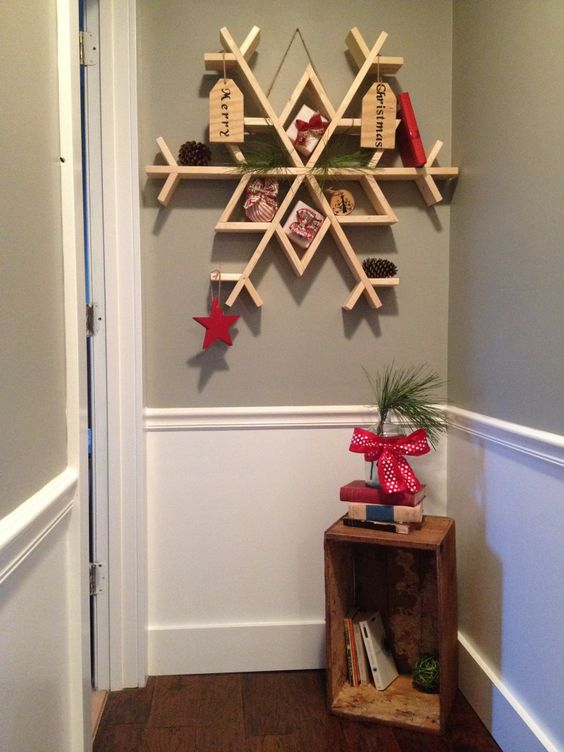 a gorgeous snowflake shelf with tags, pinecones, stars and gifts can be squeezed into a very small nook