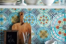 12 blue mosaic tiles on your backsplash make your kitchen really Mediterranean