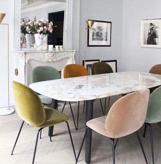 same chairs in mismatched muted tones make this dining space much more interesting