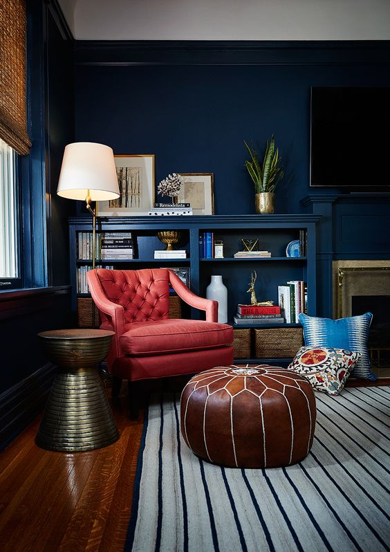 a coral diamond upholstery leather chair contrasts the bold navy space
