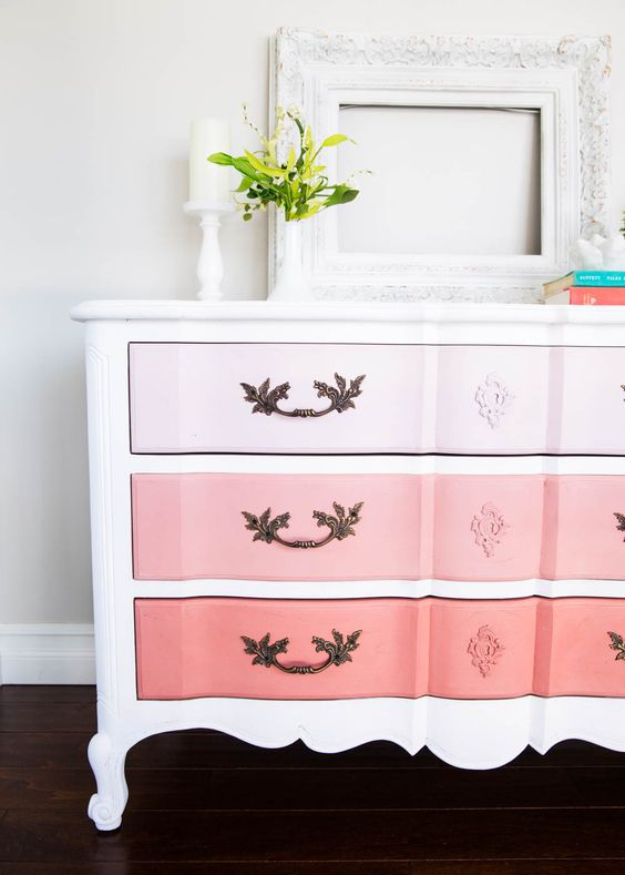 an ombre sideboard from light pink to coral with a refined vintage design and chic handles