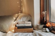 13 create a cozy reading nook by the window and if natural light isn't enough, add LEDs