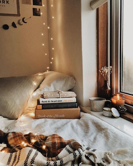 create a cozy reading nook by the window and if natural light isn't enough, add LEDs