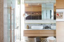 14 The bathrooms are as stylish as the rest of the house, featuring white marble walls and glass enclosures