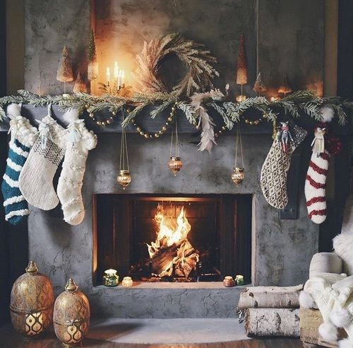 a fireplace with additional candles and lanterns around are enough to give your space cozy light