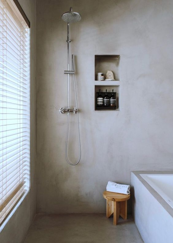 a neutral bathroom completely done with concrete is a trendy minimalist space