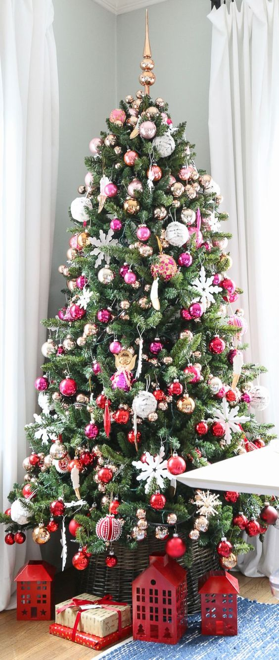an ombre Christmas tree from silver and pink to hot pink and red is a bright idea, white snowflakes tie up all the parts