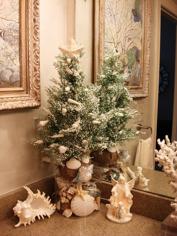 if you have a beachy bathroom, keep the holiday decor beachy, decorate your tree with shells