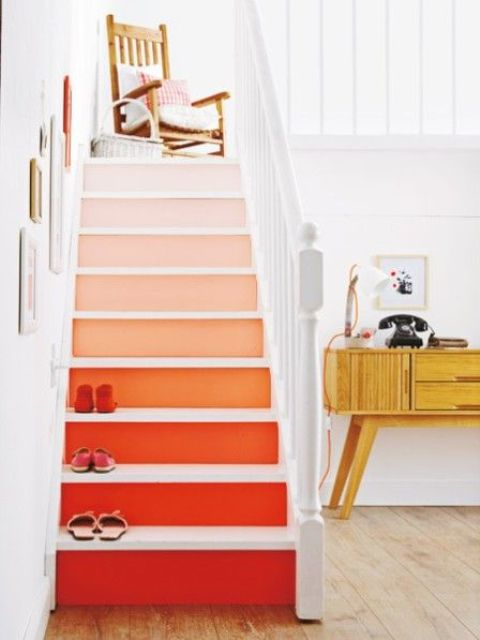 spruce up your home decor with bold stairs with an ombre effect, from light pink to deep red