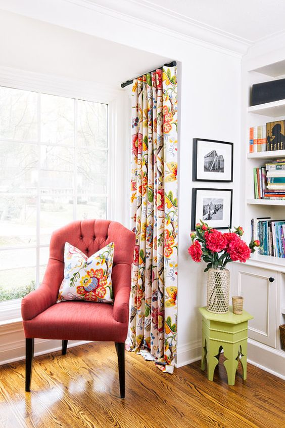 a coral upholstered chair is great addition to your reading nook, it's an easy way to cheer up your nook