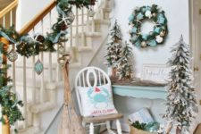 15 a cozy entryway nook with a beachy wreath and garland with floats, ornaments and star fish plus oars