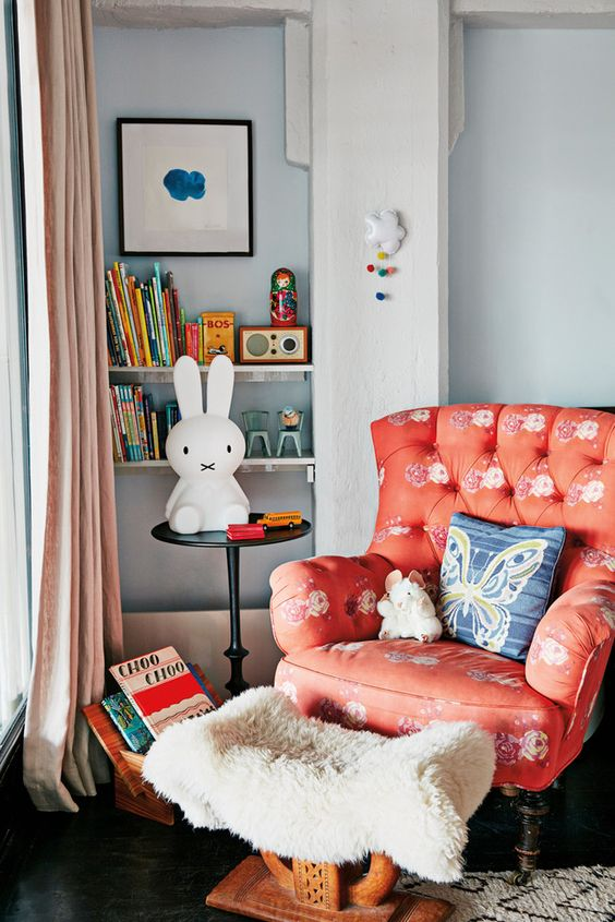 a coral whimsy chair with a floral print is a cute furniture item for a girl's nursery and a trendy touch