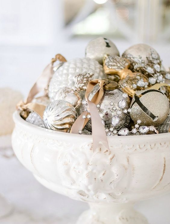 a vintage bowl with silver and gold glitter Christmas ornaments for a shiny touch on your table or mantel