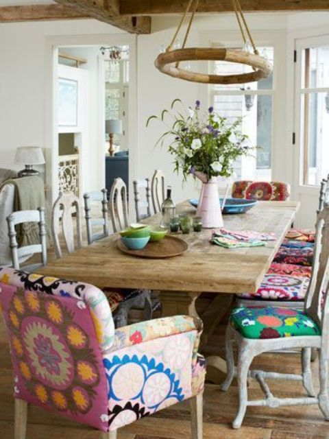 dining area with mismatched upholstered chairs
