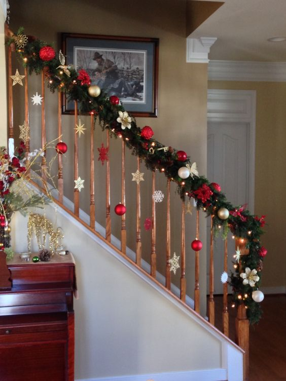 decorate the railing with evergreens and some ornaments of your choice, no floor space taken