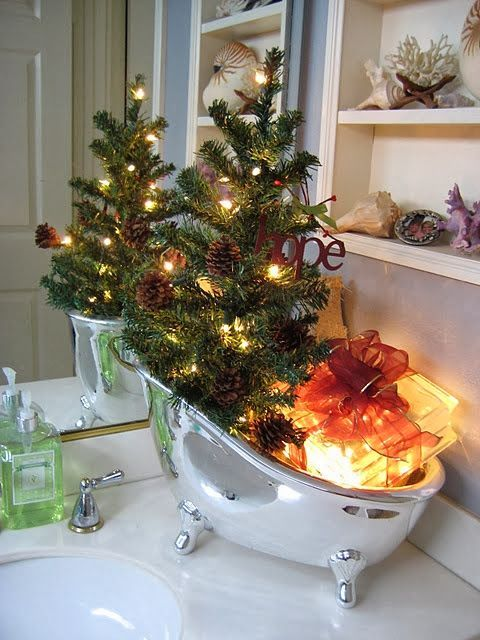 fill your soap bowl with lights, gifts and a Christmas tree with pinecones and lights instead of soaps