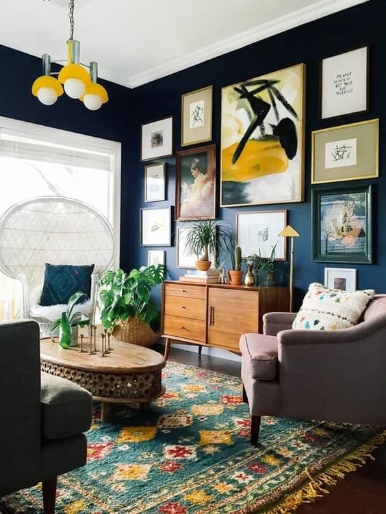 a gallery wall is often a bold and colorful centerpiece idea for an eclectic space, besides, it's trendy