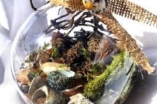 17 a glass ornament with shells, moss, net and some burlap on top is a gorgeous idea for a beachy Christmas