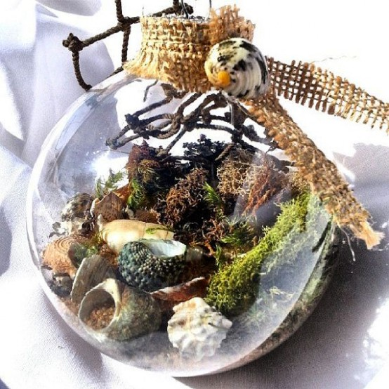 a glass ornament with shells, moss, net and some burlap on top is a gorgeous idea for a beachy Christmas
