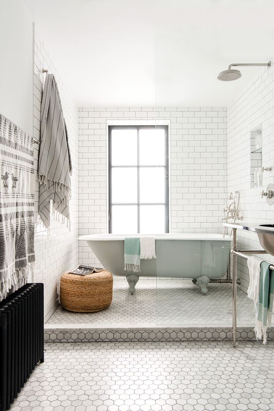 a peaceful space done with subway and hexagon tiles, accented with mint and wicker touches