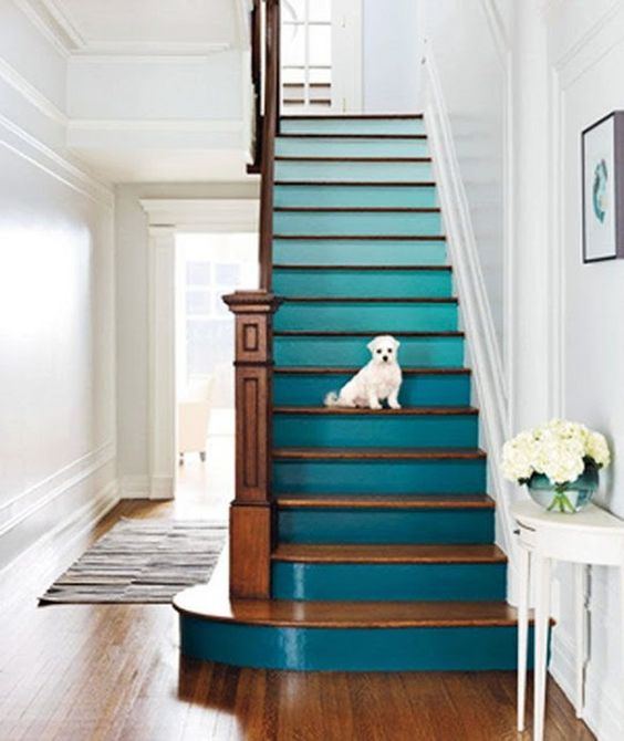 an ombre staircase from light blue to teal is a fantastic idea to spruce up usual stairs