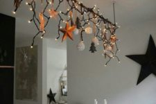 17 create an overhead decoration over the dining table and add lights to make your meals more festive