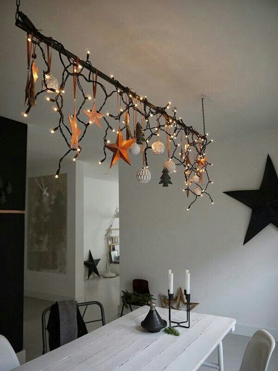 create an overhead decoration over the dining table and add lights to make your meals more festive
