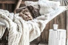 17 faux fur and knit blankets are amazing for creating a soft and welcoming space with a hygge feel