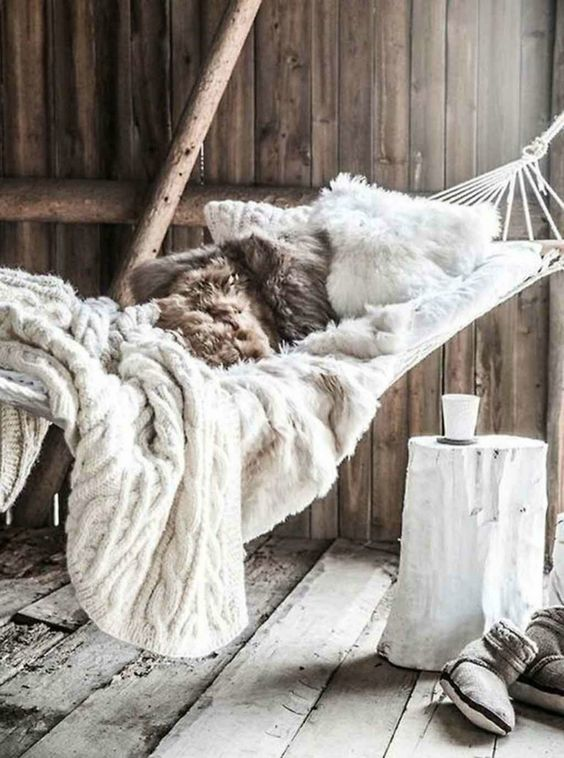 faux fur and knit blankets are amazing for creating a soft and welcoming space with a hygge feel