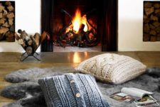 18 a faux fur rug and cable knit pillows are amazing to create a little cozy nook by the fireplace