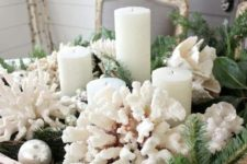 18 a gorgeous beach Christmas centerpiece with a dough bowl, corals, evergreens, candles and ornaments is easy to recreate