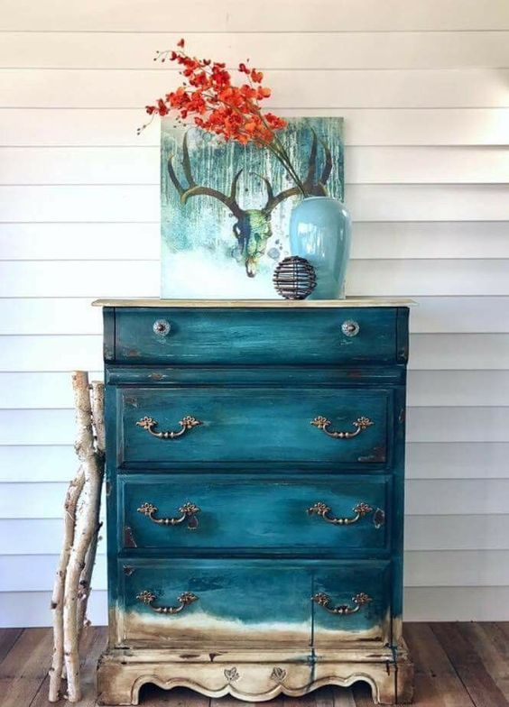 a gorgeous ombre vintage dresser from teal to neutral wooden shades is perfect item for a beach home