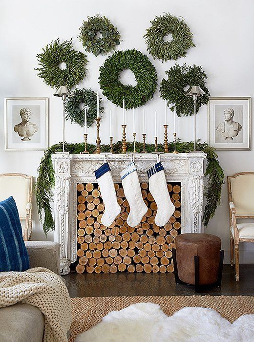 an arrangement of lush greenery wreaths and a matching garland on the mantel will brign a natural feel to the space