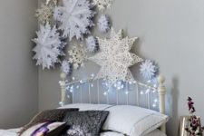 18 decorate the wall with paper snowflakes and lights to create a charming ambience while sleeping