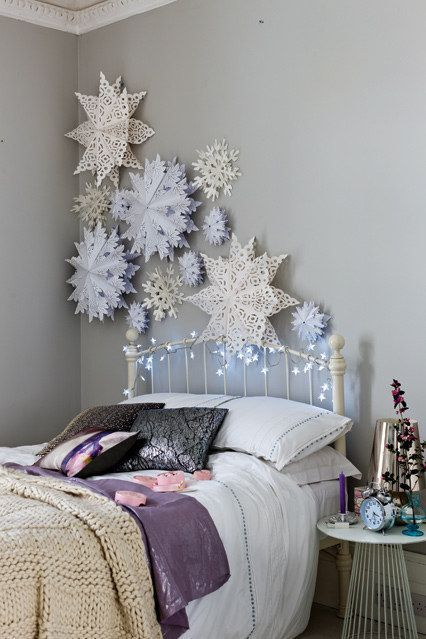 decorate the wall with paper snowflakes and lights to create a charming ambience while sleeping