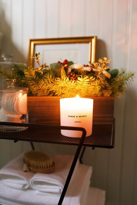 place a winter scented candle and a box with evergreens, pinecones and fake berries to achieve a holiday look