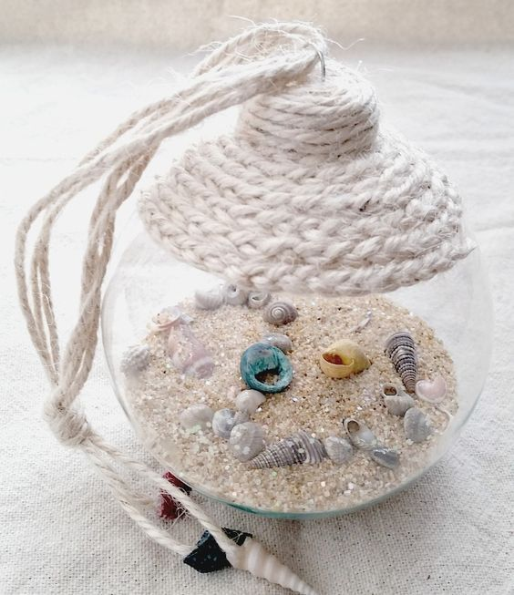 a gorgeous beach Christmas ornament with sand, little seashells and twine wrap on top