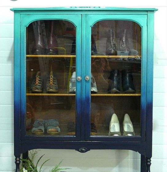 a vintage shoe cabinet with a gradient effect from turquoise to navy is a bold and beautiful option